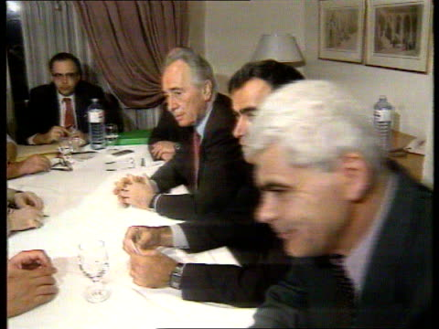 home rule agreement reached between israel and the plo itn taba israel for min shimon peres along with taba others towards and past pan cms plo... - シモン・ペレス点の映像素材/bロール