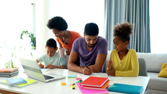 vídeos de stock e filmes b-roll de home schooling during coronavirus quarantine. - african american ethnicity