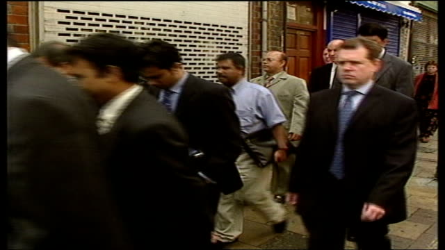 home secretary david blunkett visits brick lane; itn england: london: brick lane: int gvs david blunkett into police station office & introduced to... - david blunkett stock videos & royalty-free footage