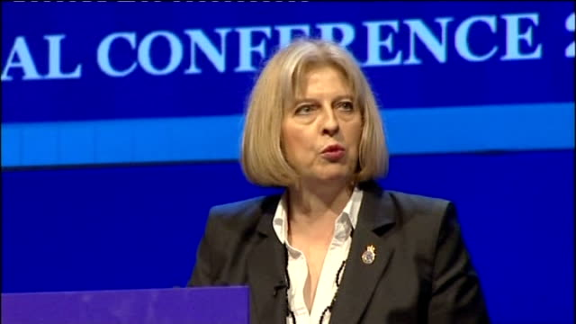 home secretary given cool response by the police federation; england: dorset: bournemouth: int theresa may mp introduced by tv presenter john... - stapleton stock videos & royalty-free footage