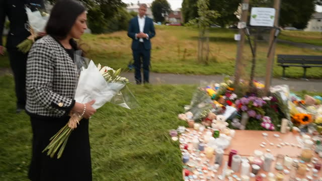 home secretary priti patel leaving flowers at a memorial for victims of the plymouth shootings - monument stock videos & royalty-free footage