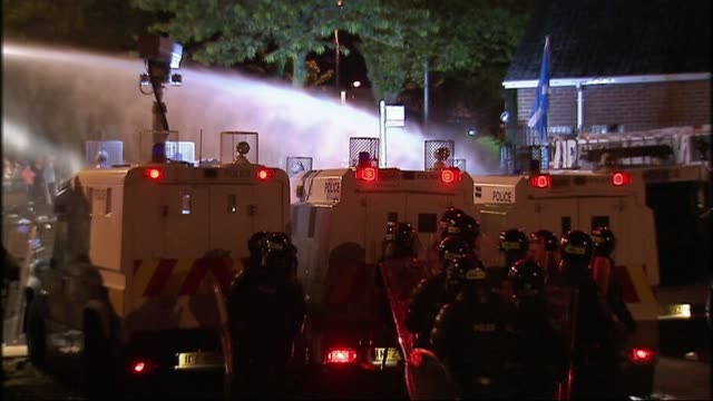 home secretary rules out use of water cannons; recent northern ireland: belfast: ext / night various shots of water cannon being deployed in street - water cannon stock videos & royalty-free footage