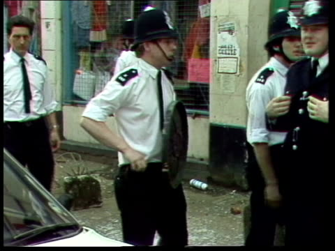 vídeos de stock, filmes e b-roll de home secretary william whitelaw orders urgent study into the need for new police riot gear date unknown police policeman with bin lid officer... - brixton
