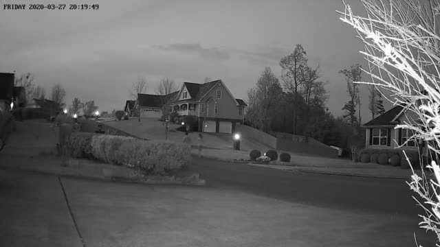 home security camera point of view of couple taking a walk at evening during the 2020 global coronavirus pandemic - modern art stock videos & royalty-free footage
