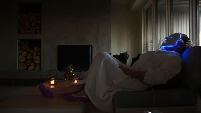 diy home spa man alone home sofa - bathrobe stock videos & royalty-free footage