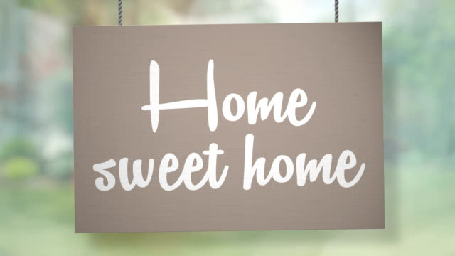 Home sweet home sign hanging from ropes. Luma matte included so you can put your own background.