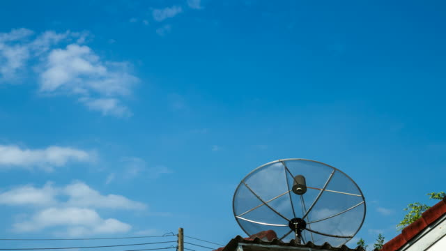 t/l home tv satellite dish with blue sky in thailand - satellite tv stock videos and b-roll footage
