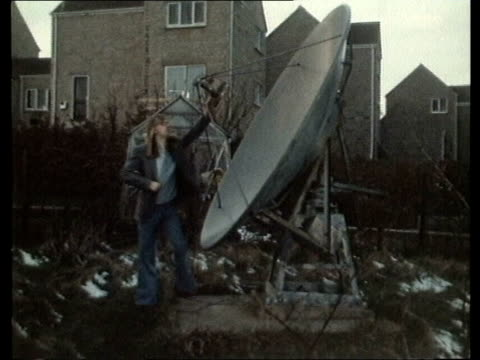 home tv satellites; home tv satellites; england: sheffield mr steve burkhill by dish in garden cone of dish dish - sheffield stock videos & royalty-free footage