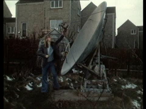 home tv satellites home tv satellites england sheffield ms mr steve burkhill by dish in garden cs cone of dish ms dish - sheffield video stock e b–roll