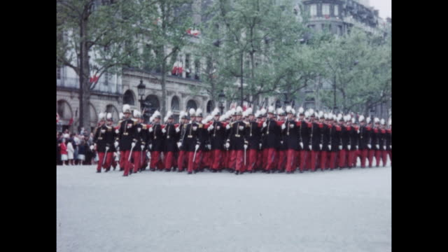 vídeos de stock, filmes e b-roll de home video footage of a military parade on bastille day on the avenue des champselysees circa july 1958 - 1958