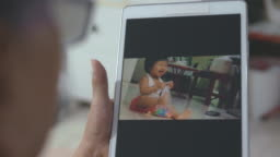 Home Video : Grandmother using electronic devices