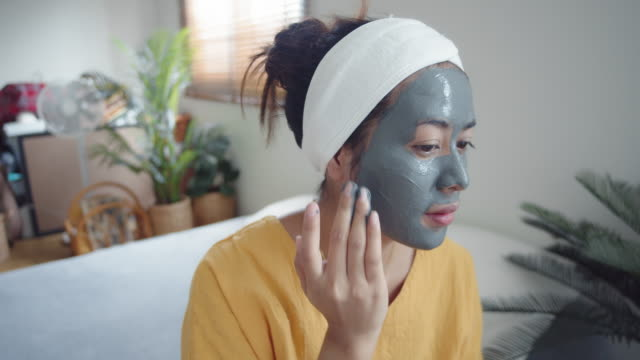 home wpa woman  women applying a facial mask - spa treatment stock videos & royalty-free footage