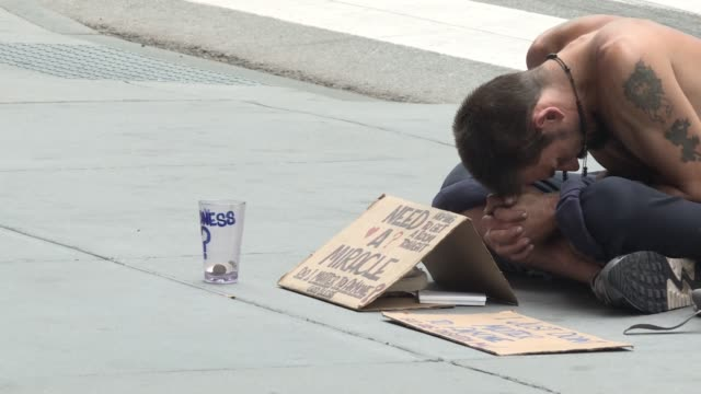 Homeless and pan handlers in midtown manhattan / late summer / early fall begging for change and help