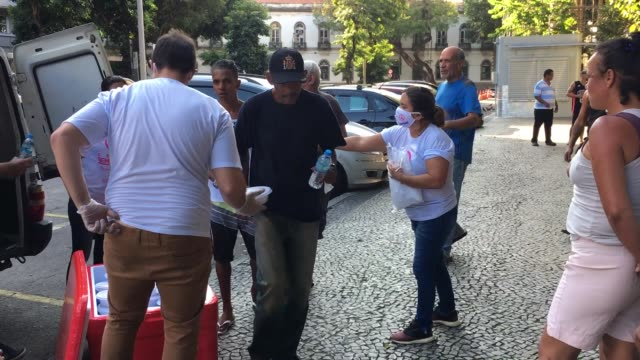 homeless and unemployed people receive food and water from volunteers of the 'covid sem fome' on april 22 2020 in rio de janeiro brazil 'covid sem... - unemployment stock videos & royalty-free footage