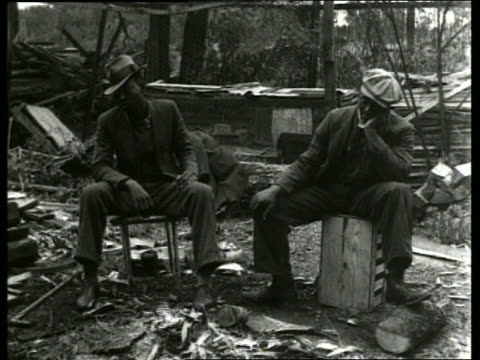 B/W 2 homeless black men sitting in garbage dump / Depression / SOUND