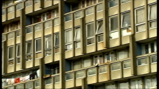 homeless charity centrepoint warns of housing crisis in london large block of flats street of terraced houses houses with estate agents boards outside - wohnungsprobleme stock-videos und b-roll-filmmaterial