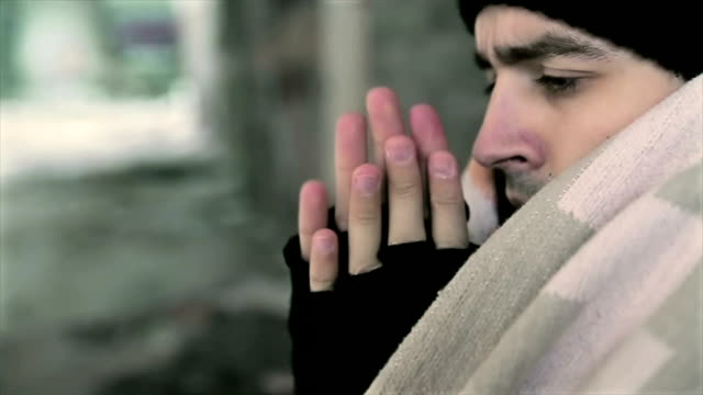 homeless heats his hands - cold temperature stock videos & royalty-free footage