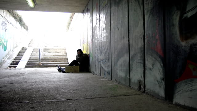 hd dolly: homeless in the underpass - homelessness stock videos & royalty-free footage