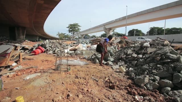 LS Homeless lady scavenging for scrap metal A homeless lady lives under a bridge that is being built for the FIFA 2014 World Cup and the 2016 Summer...