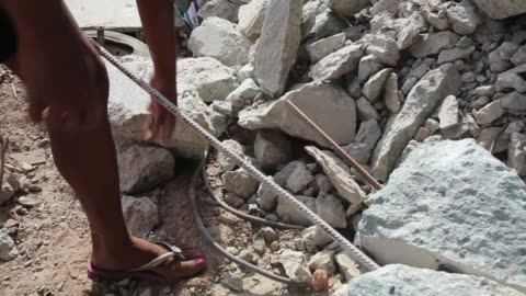 homeless lady scavenging for scrap metal. a homeless lady lives under a bridge that is being built for the fifa 2014 world cup and the 2016 summer... - scavenging stock videos & royalty-free footage