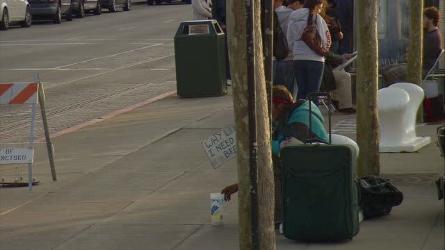 ws homeless man at fisherman's wharf holding handcrafted sign which reads: 'why lie. i need a beer', san francisco, california, usa - homelessness stock videos & royalty-free footage