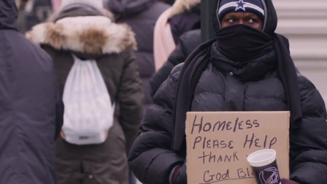 homeless man holding sign on street for money, close-up - homelessness stock videos & royalty-free footage