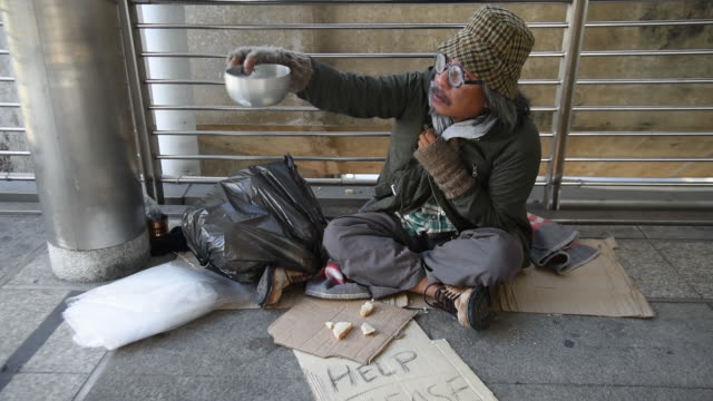 homeless man is calling people to give something - beggar stock videos & royalty-free footage