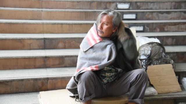 homeless man is covered blanket on hisself to prevent cold weather - blanket stock videos & royalty-free footage