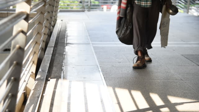 homeless man is walking through the way - tramp stock videos & royalty-free footage