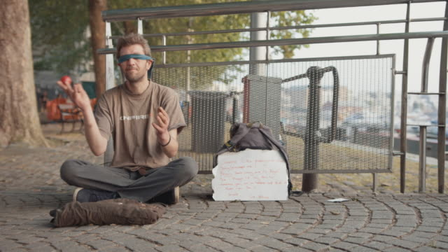 homeless man juggling sitting on sidewalk in city - performer stock videos & royalty-free footage