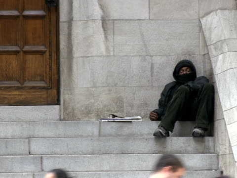 ms homeless man seeping on church steps pedestrians in foreground new york city new york usa - only mature men点の映像素材/bロール