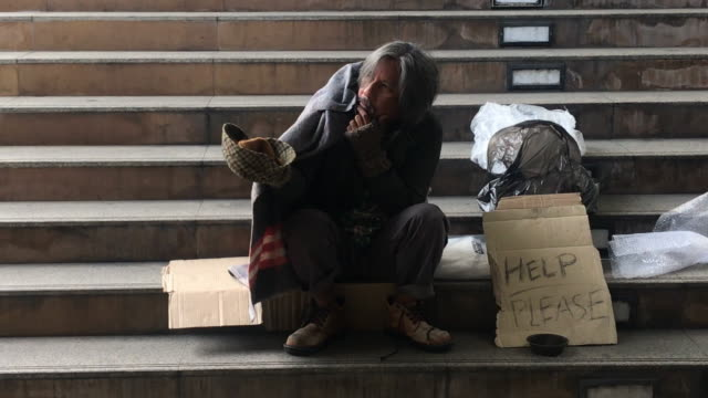 homeless man sit on the stair and begging people - beggar stock videos & royalty-free footage
