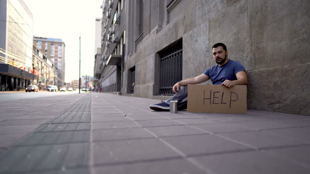homeless man sitting and begging for help - beggar stock videos & royalty-free footage