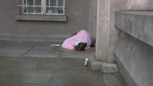 (hd1080i) homeless man sleeping on the street - mental illness stock videos and b-roll footage