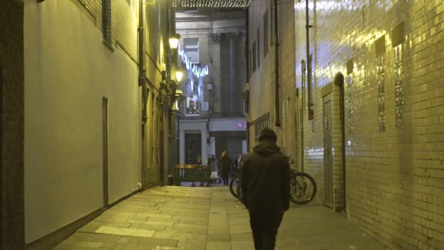 homeless man walking down alleyway night christmas miserable sad city night dark - homelessness stock videos & royalty-free footage