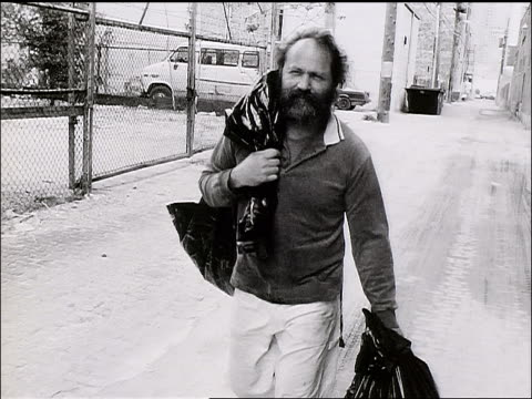 b/w homeless man with beard walking with garbage bags - one mid adult man only stock videos & royalty-free footage