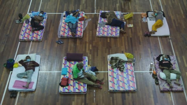 homeless people are seen at the pusat komuniti sentul perdana on april 1, 2020 in kuala lumpur, malaysia during coronavirus outbreak. - kuala lumpur stock videos & royalty-free footage