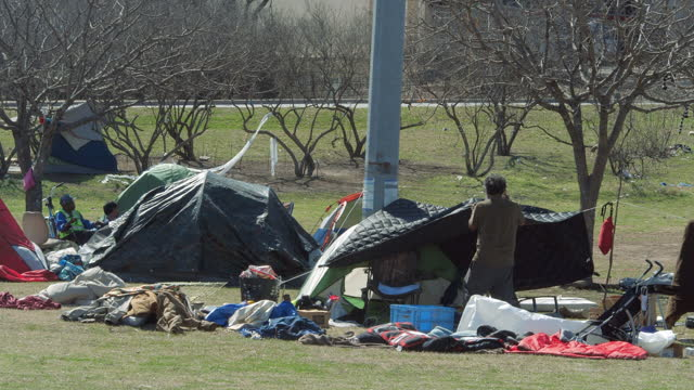 homeless people live in tents on the street in austin amid the covid-19 pandemic. there are 2506 homeless people in 2020 according to austin's ending... - recession stock videos & royalty-free footage