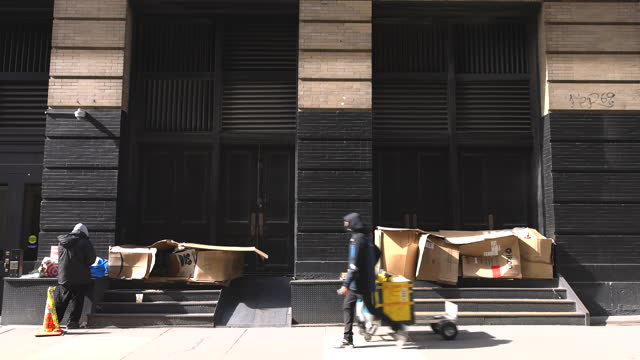 homeless people make shelter using cardboard boxes in soho new york city. - loft apartment stock videos & royalty-free footage