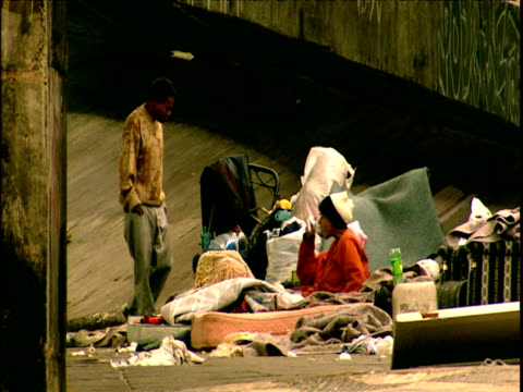 homeless people sleeping in rundown part of city with political graffiti on walls sao paulo - socialism stock videos & royalty-free footage