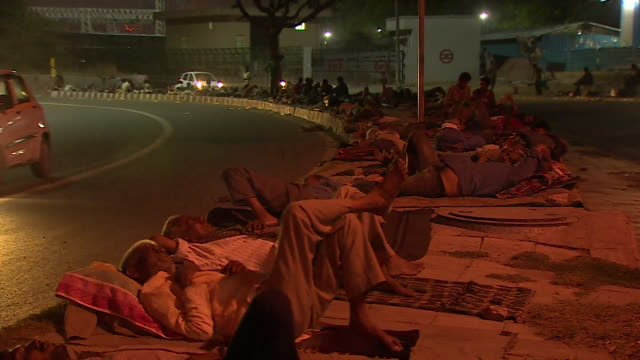 Homeless people sleeping rough on New Delhi streets