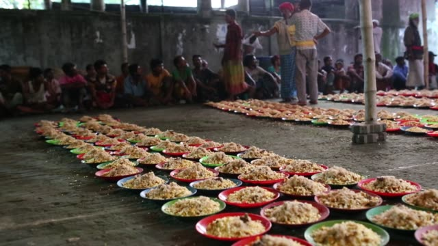 Homeless people waits for eat fastbreaking dinner during the Islamic holy month of Ramadan at the High Court of Mazar in Dhaka Bangladesh on May 19...