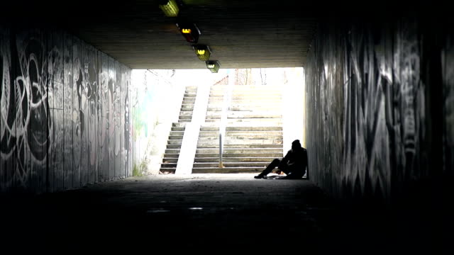 hd dolly: homeless person eating in an underpass - underpass stock videos and b-roll footage