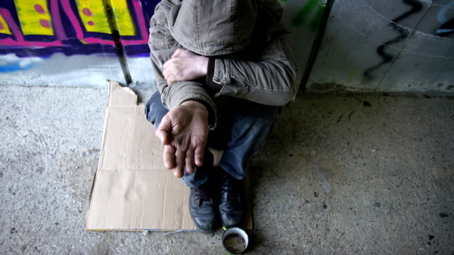 hd dolly: homeless person holding an open palm - begging social issue stock videos and b-roll footage