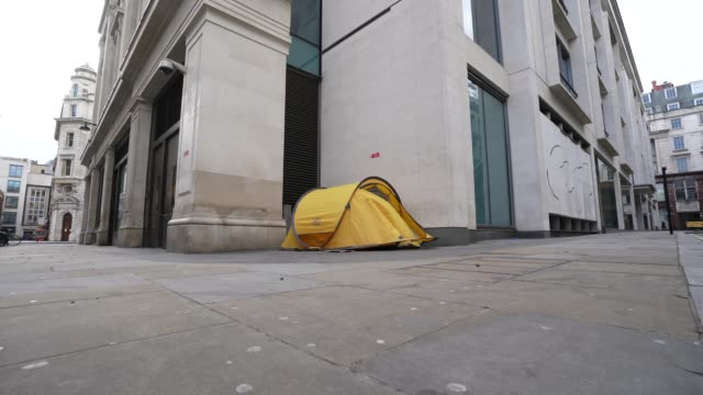 homeless person living in a tent around an empty street of soho on march 31, 2020 in london, england. like many other countries around the world, the... - homelessness stock videos & royalty-free footage