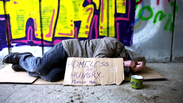 hd dolly: homeless person sleeping in the underpass - help single word stock videos and b-roll footage