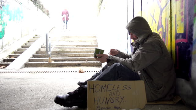 hd super slow-mo: homeless person with a cigarette - begging social issue stock videos and b-roll footage