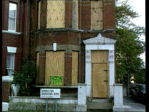 repossesed properties cf tape no longer available england cms for sale sign pull out to boarded up tx london house itn lams ditto ms estate agent for... - economy stock videos & royalty-free footage