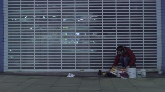 homeless street drummer city uk night music musician begging talented