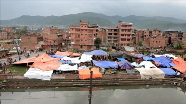 homeless survivors of saturdays massive earthquake shelter in makeshift tents in kathmandu - homeless shelter stock videos & royalty-free footage